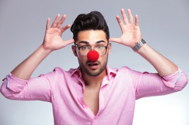 fashion young man with red nose acting crazy