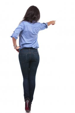 back of a casual woman pointing away