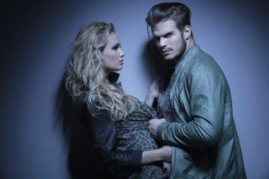 dramatic fashion couple posing