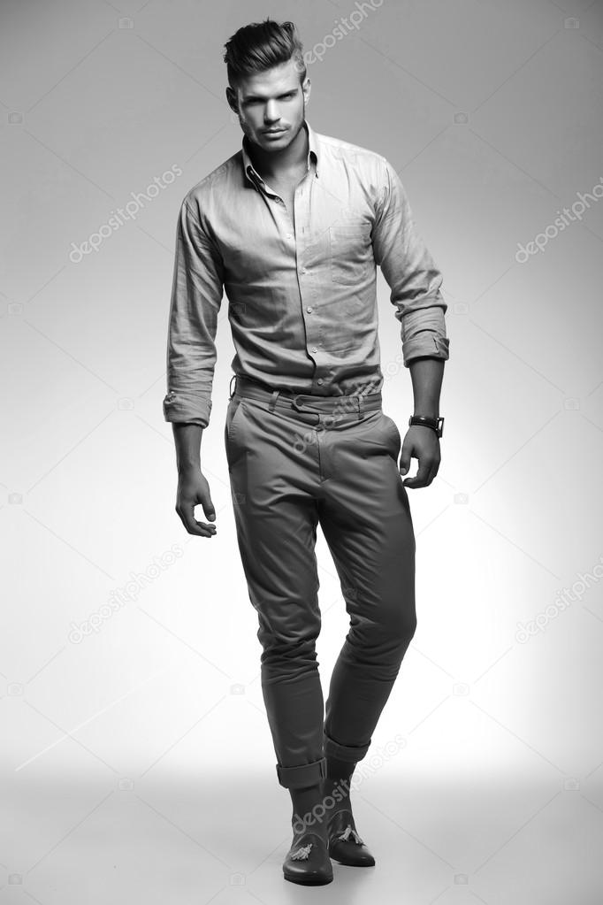 casual man walks forward