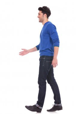 casual man in blue jeans and shirt walking
