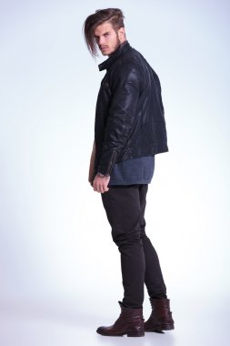 back view of a young fashion man in leather jacket