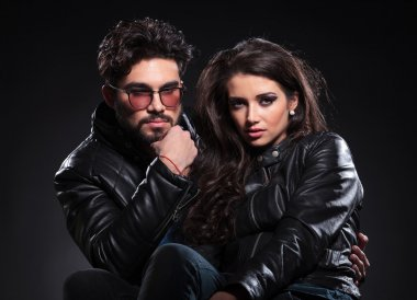 serious fashion couple in leather jackets