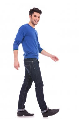 Young man laughing and walking