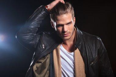 young fashion man passing his hand through his hair