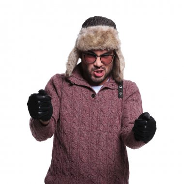 man in fur hat and leather gloves is driving an imaginary race c