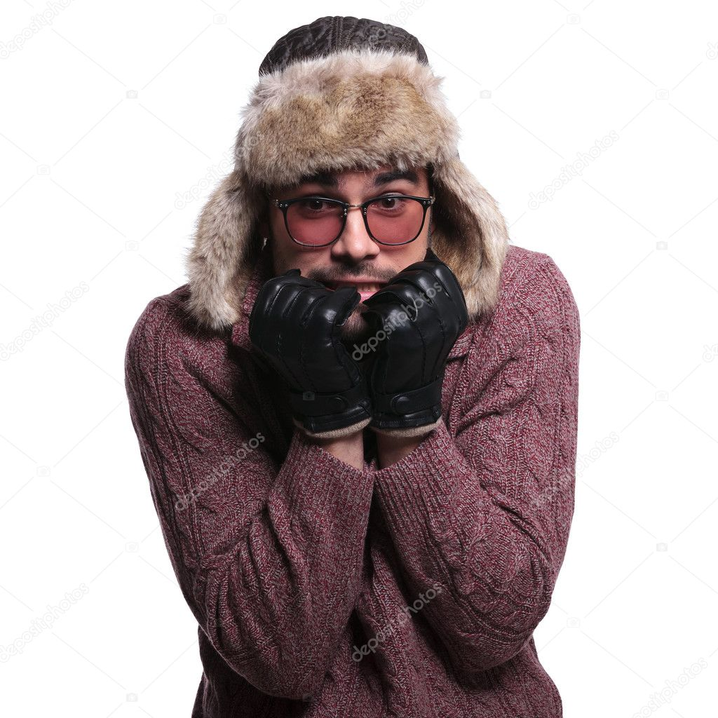 young man is being scared about the winter cold