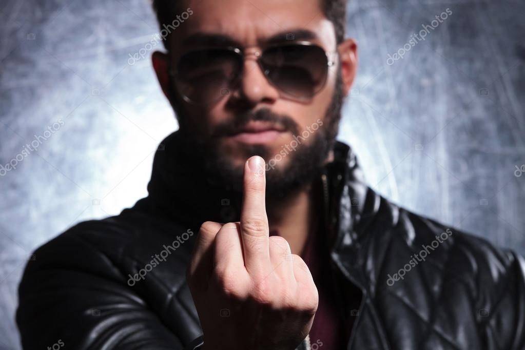 Man with long beard and sunglasses giving you the finger