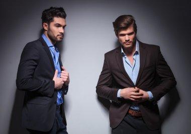 two male fashion models posing in studio