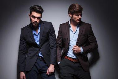 pair of male models posing in studio