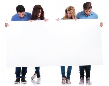 casual people holding and looking at a blank board