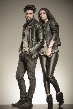 fashion couple in casual leather jackets posing