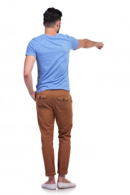 back view of a young casual man pointing his finger