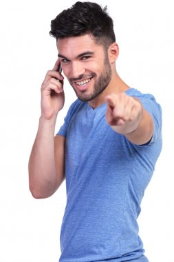 smiling casual man pointing his finger on the phone