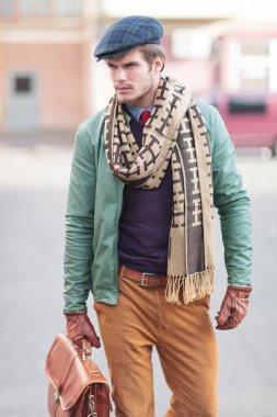 elegant young fashion casual man walking