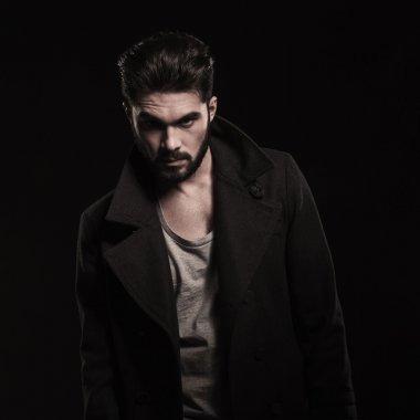 fashion young bearded man wearing long coat with big collars