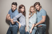 Photo Fashion models in blue jeans and casual polo shirts