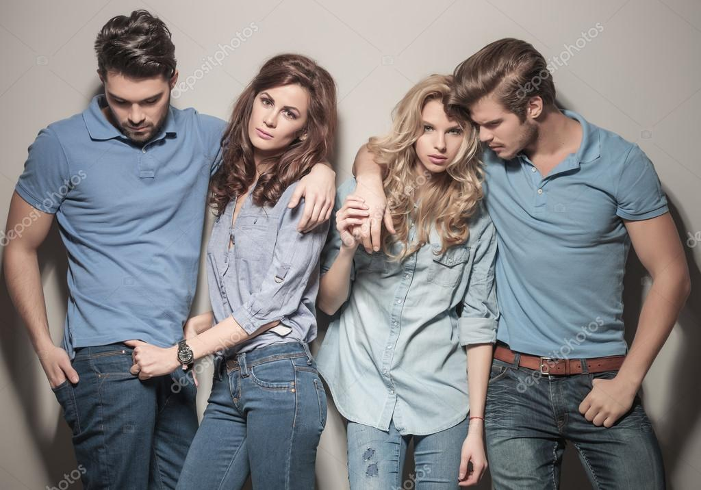Men and women standing together in casual jeans clothes