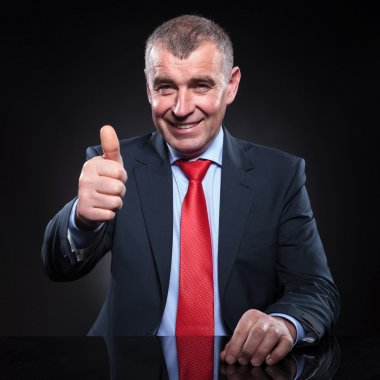 Mature business man making the ok sign