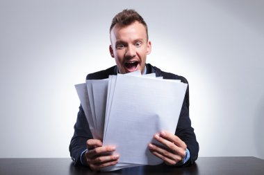 Business man shocked by many bills