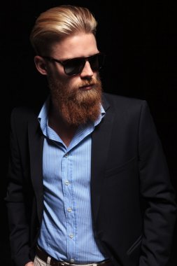 bearded business man looks at his left