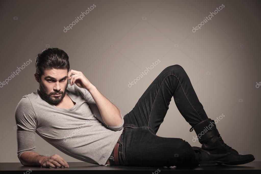 Man lying down on the floor and thinking stock photo for Down to the floor