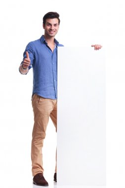 man presenting a big board and makes the ok sign