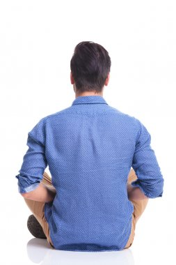 back veiw of a seated young brunette man