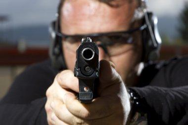 Man shooting on an outdoor shooting range