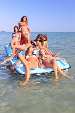 six beautiful young women on a pedalo boat