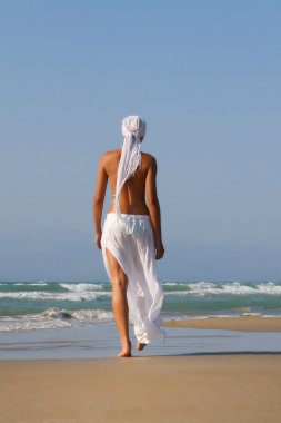 woman topless on the beach