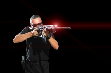 Man aiming assault rifle laser