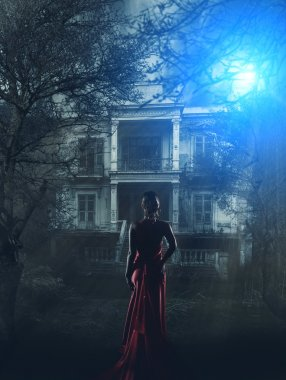 Woman in red dress at haunted house