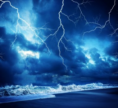 Lightning flashes across the beach durring the storm