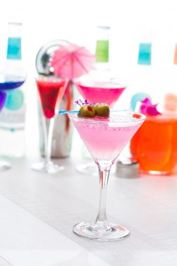 Cocktail with caviar and flower