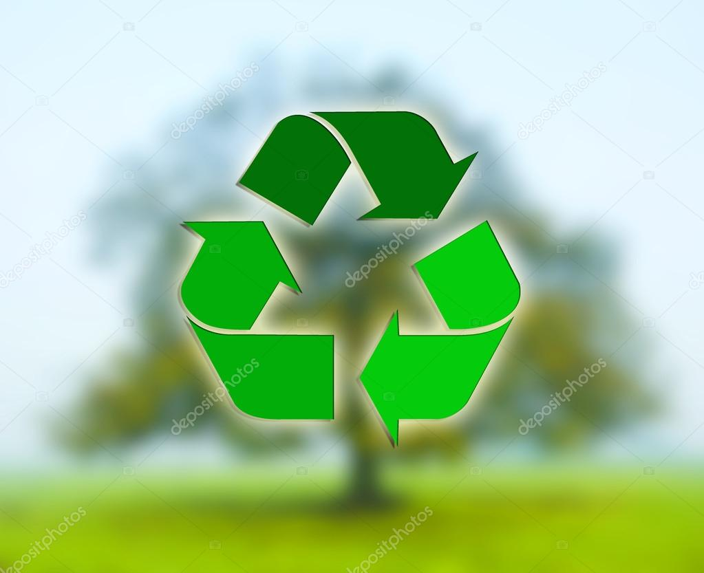 Recycling sign with deciduous tree