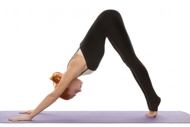 Downward facing dog asana on tiptoes