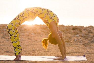 Yoga practice. Woman doing bridge pose
