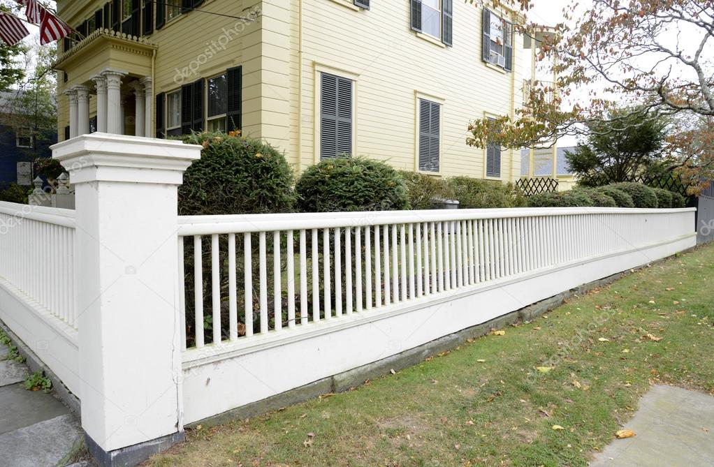 White Picket Fence By A Typical Federal Style House