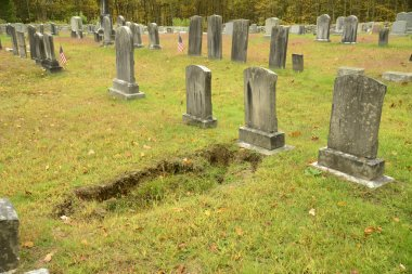 Sunken dirt by a grave in an old cemetery in connecticut stock vector