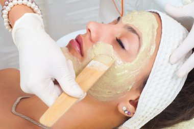 Young woman with natural facial mask