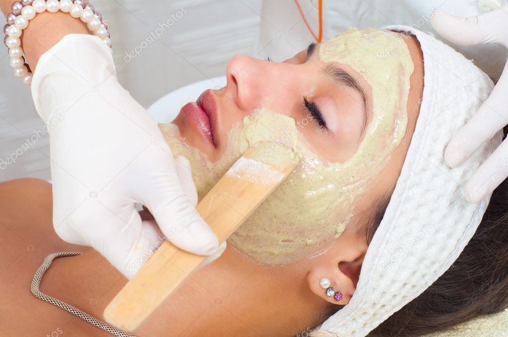Young woman with natural facial mask