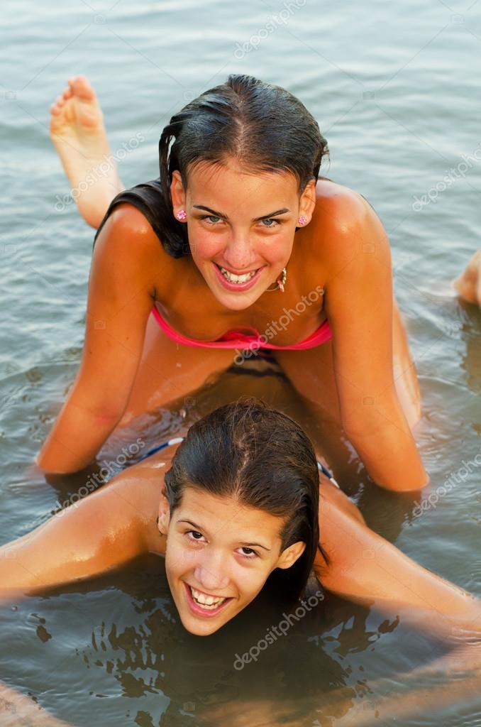 Two teenage girls having fun in the river