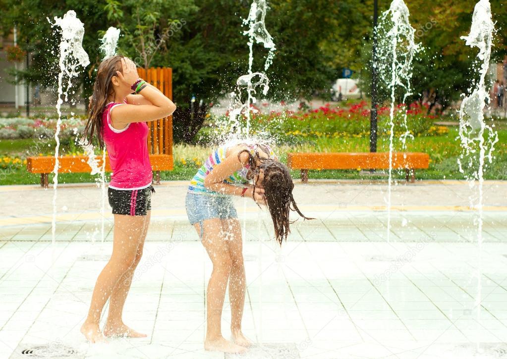 Teenage girls in the water fountain
