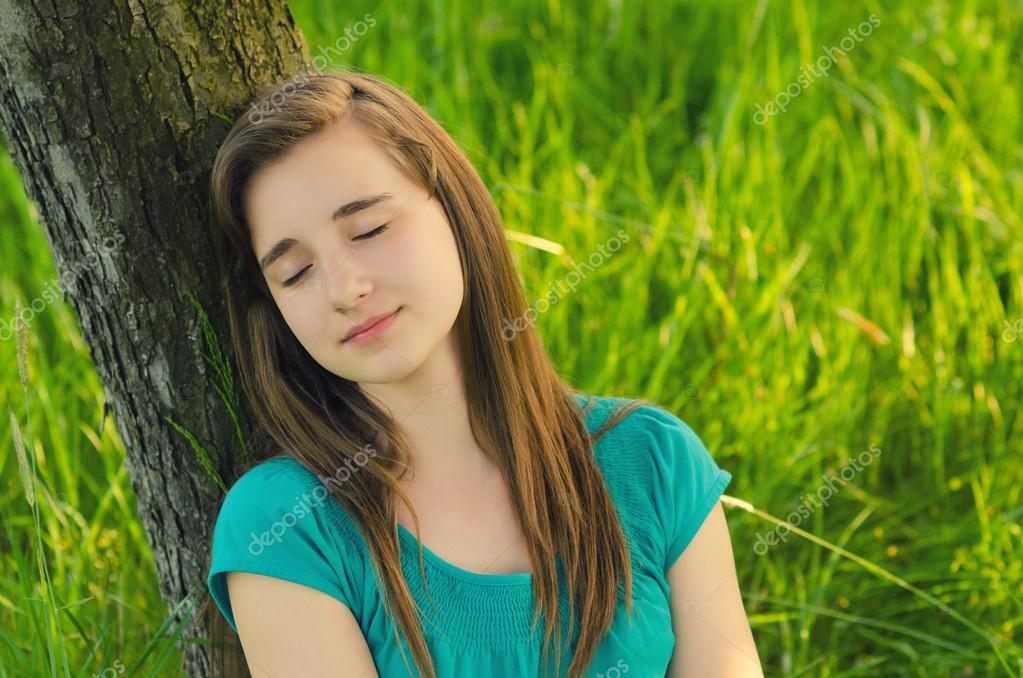 Teenage girl sleeping in the nature
