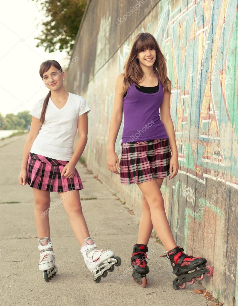 Teenage girls on roller skates having fun