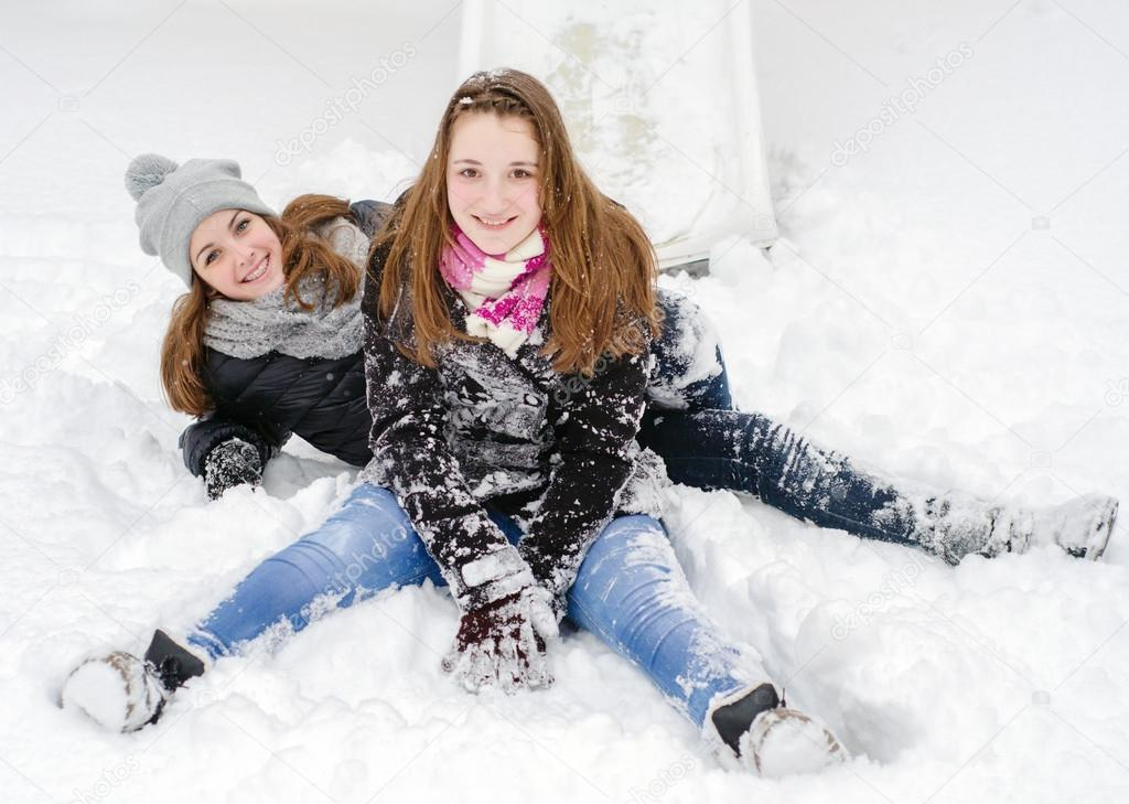 Two teenage girls having fun in the snow