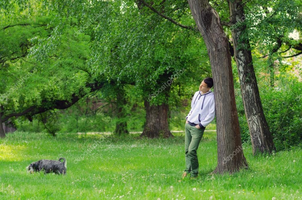 Man with dog walking in the forest