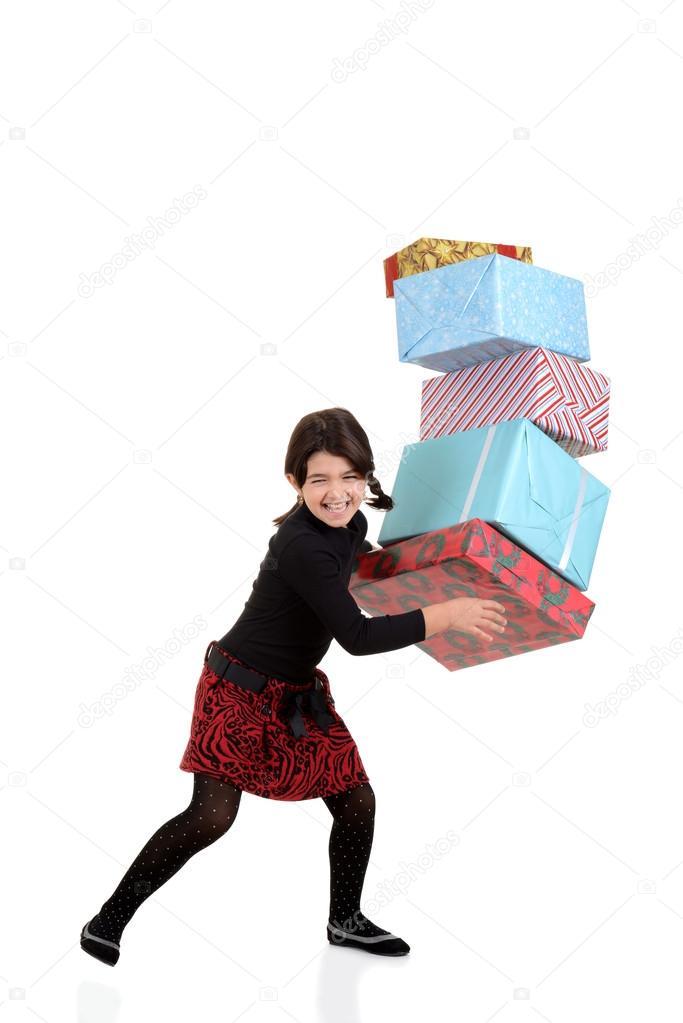 junges Mädchen fallen Haufen Weihnachtsgeschenke — Stockfoto ...