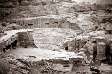 Ruins of ancient amphitheater in Petra, Jordan stock vector